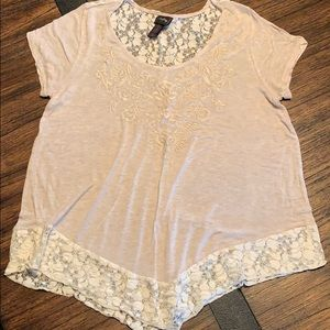 Ladies top with lace embellishment.